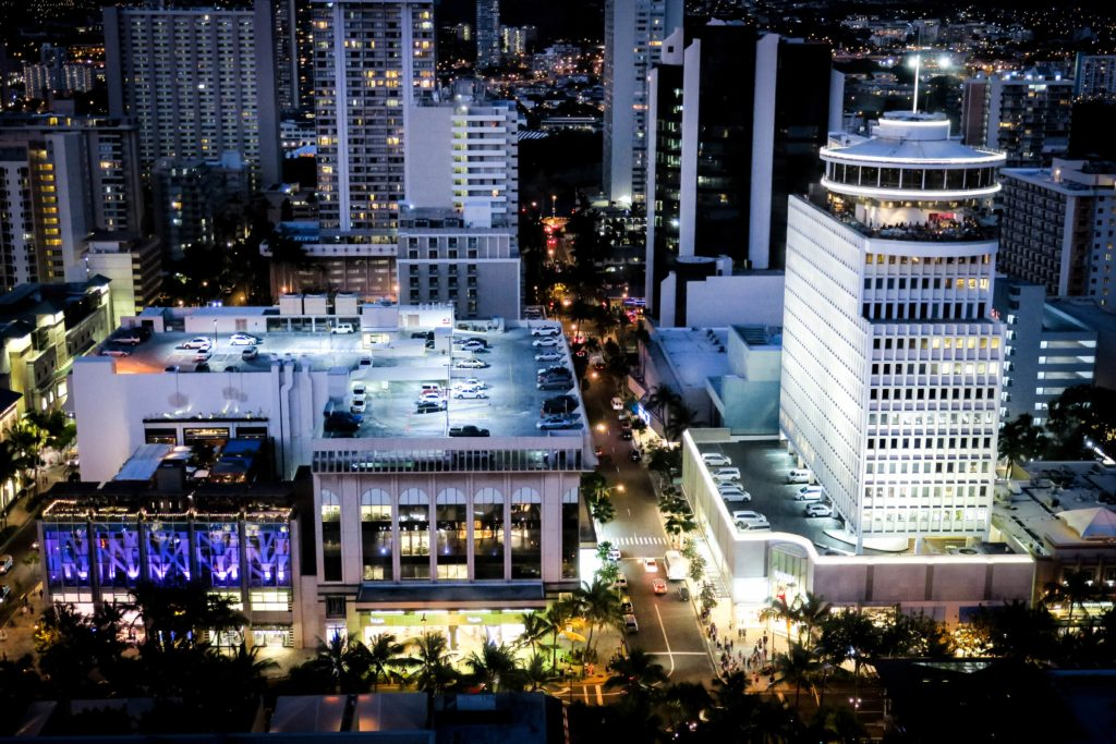 Leasing, shopping, and dining at the waikiki business plaza and waikiki shopping plaza at night