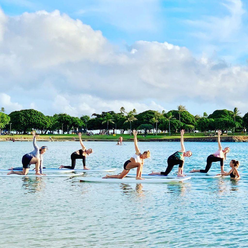 Paddleboard yoga at Ala Moana Beach