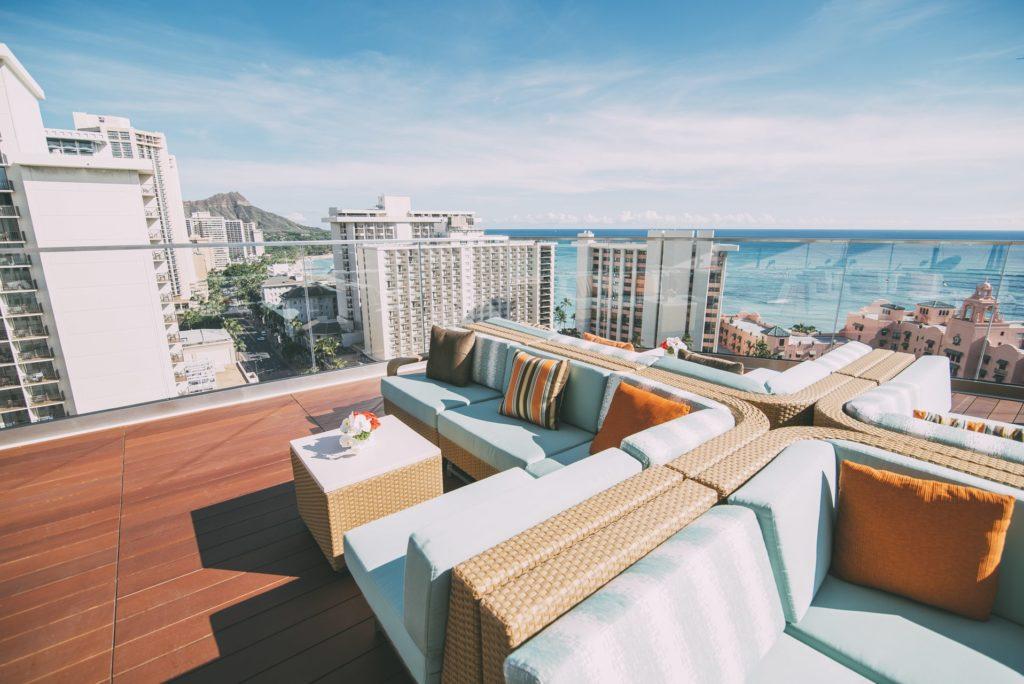 SKY Waikiki rooftop deck with a view of Diamond Head, Waikiki, and the Royal Hawaiian Pink Hotel