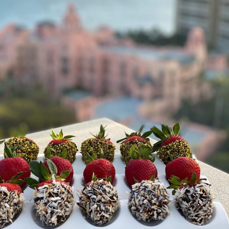 Chocolate covered strawberries in front of Royal Hawaiian