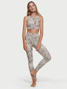 woman in pants animal print leggings and sports bra