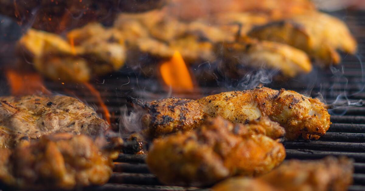 Chicken on a grill with flames