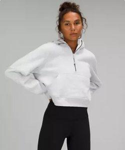 woman in a white sweathshirt