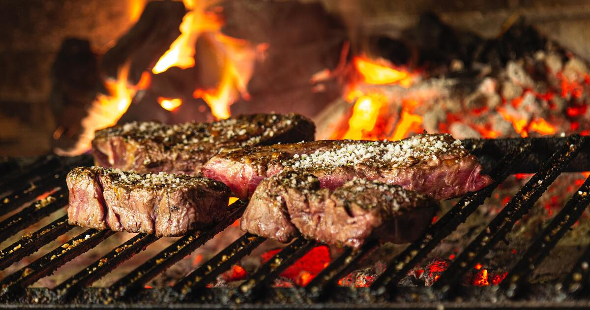 skirt stake on a grill with flames