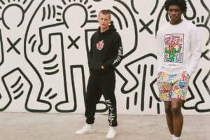 Two guys in streetwear in front of wall art