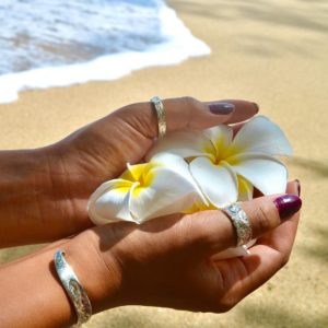 hand holding flowers on the beach