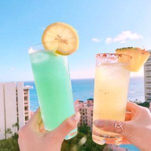 drinks overlooking waikiki beach and royal hawaiian hotel