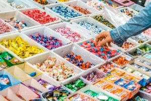 handy picking out candy from a candy store